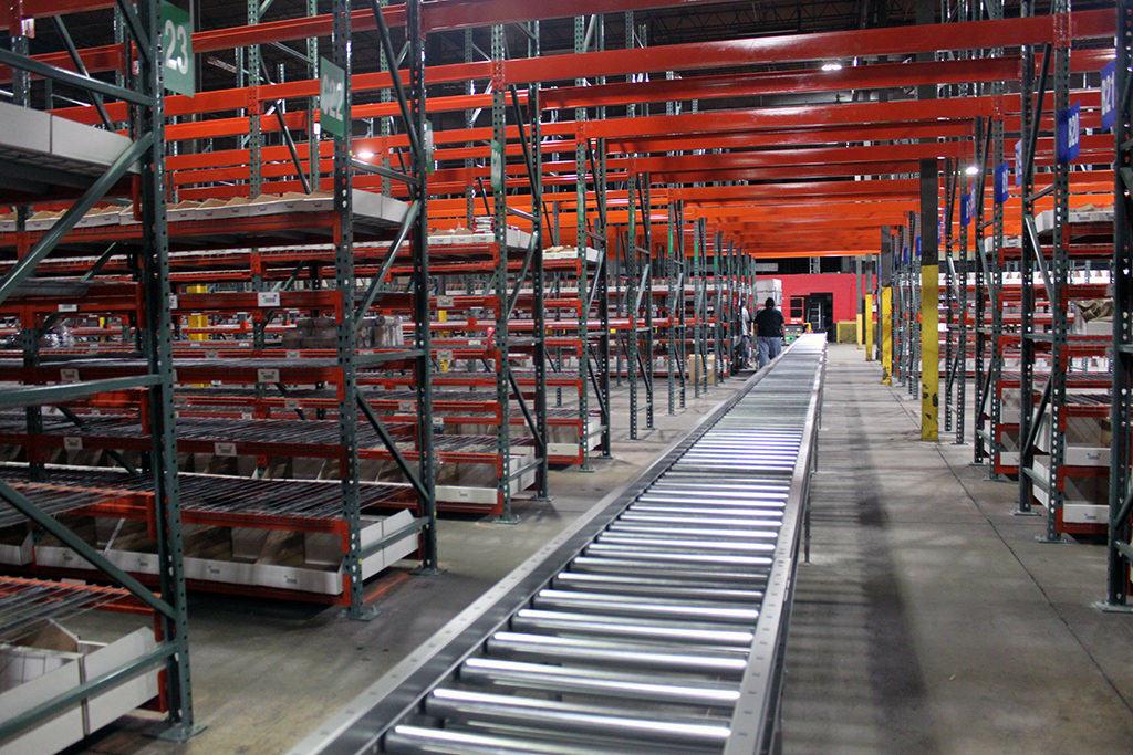 Conveyor through Selective Rack