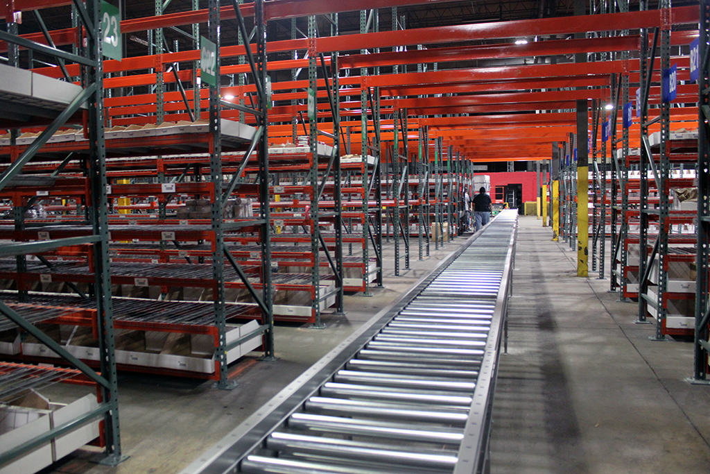Conveyor through Selective Rack